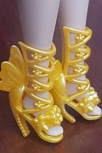 Golden/orange butterfly shoes